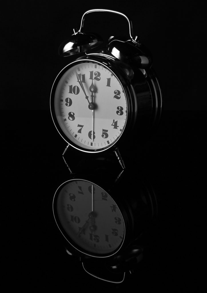 A picture of a clock reflecting itself