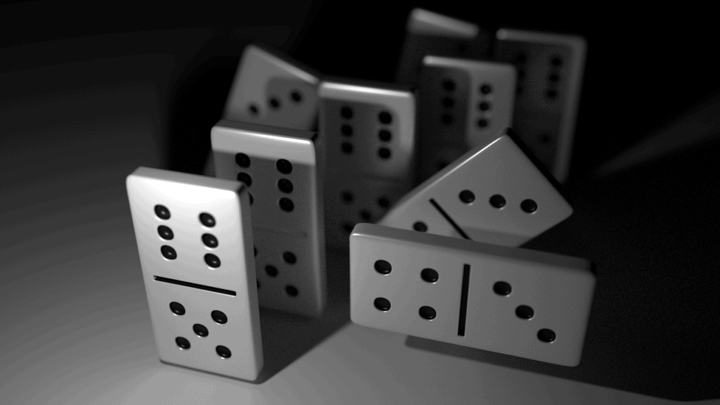 A picture of dominoes falling due to cause and effect.