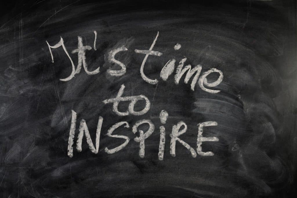 A photo of a chalk board that says it's time to inspire