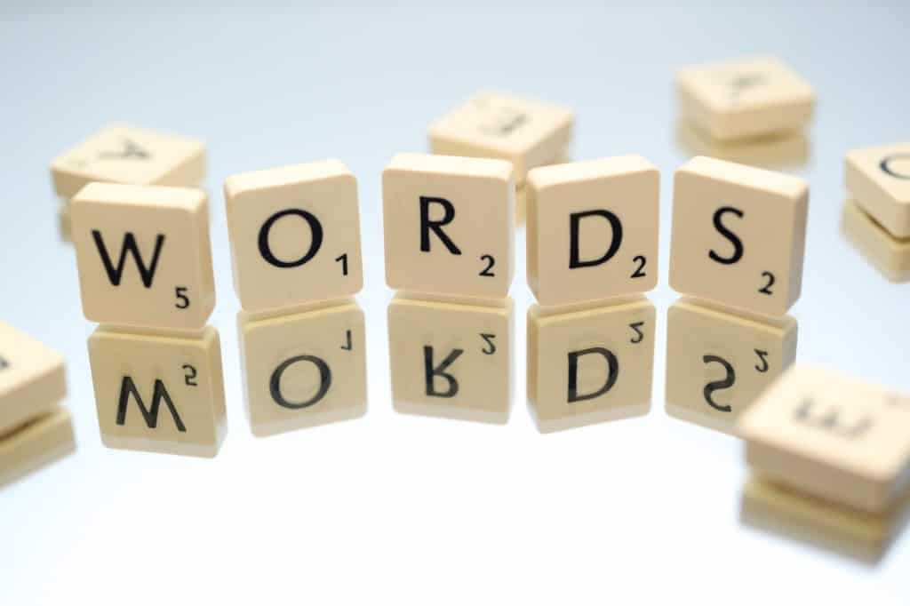 An image of scrabble tiles that spells words.