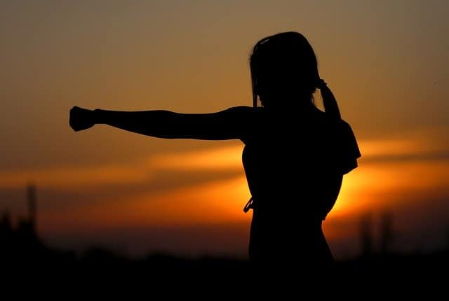 Am image of a girl learning self defense.