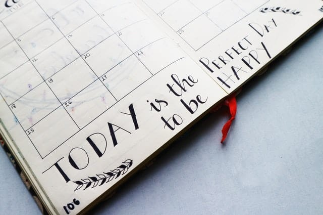 "An image of a daily planner that says  ""Today is the perfect day to be happy"""