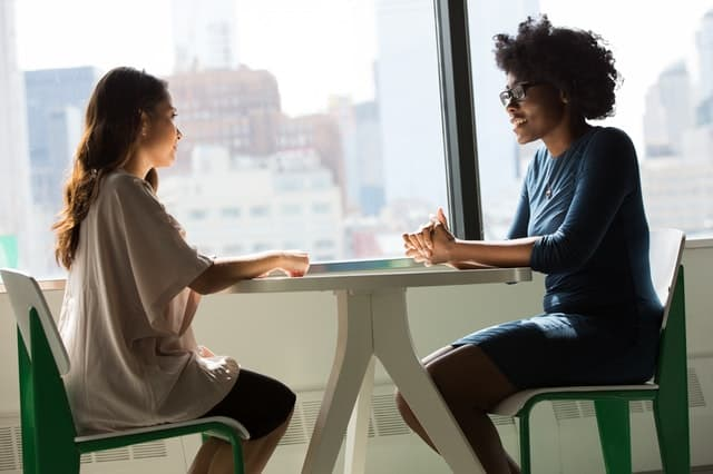 An image of two women sharing conversation