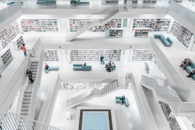 An image of an all white library from an extremely high viewpoint