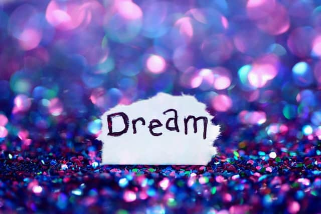 An image of the word Dream surrounded by glitter