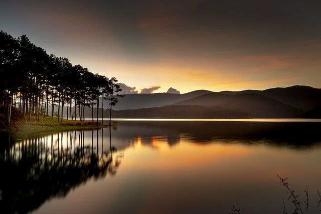 An image of a lake at sunset reflecting the sky.