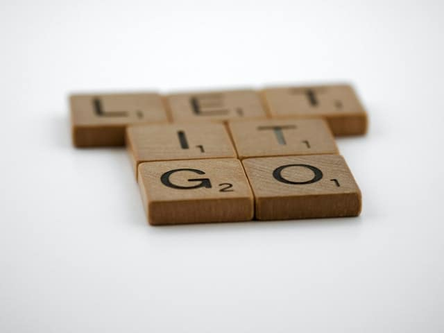 "An image of scrabble letters arranged into the phrase ""Let it go"""