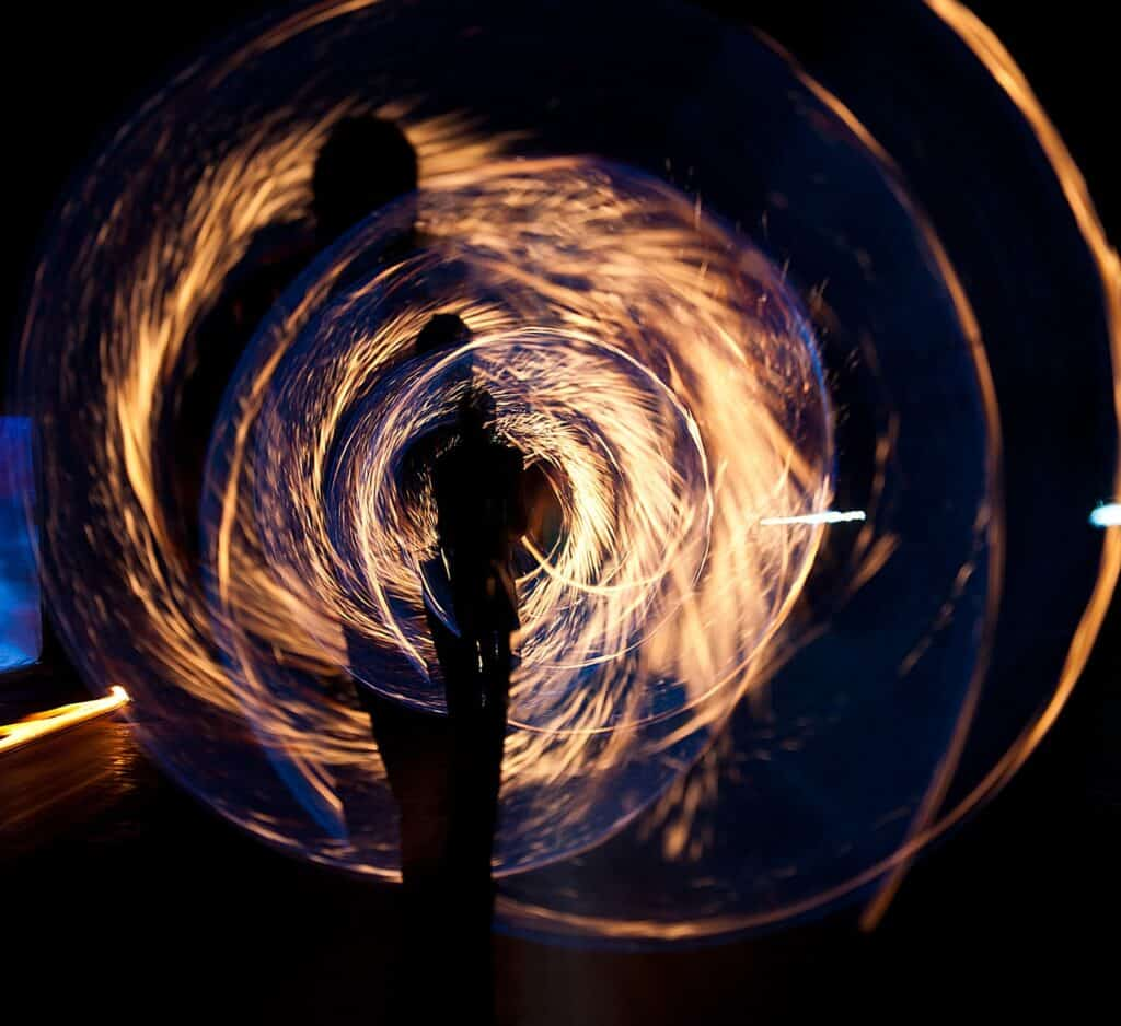 A photo of a human figure surrounded by swirling energy.