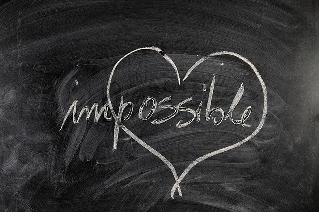An image of the word Impossible with the possible part surrounded by a heart.