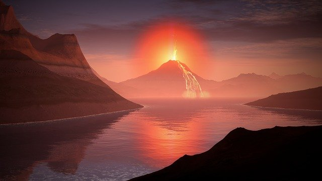 An image of a volcano erupting with flowing lava.