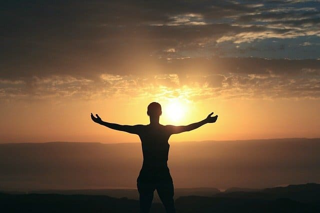 """A photo of a woman extending her arms in front of a sunrise.  Image by <a href=""""https://pixabay.com/users/avi_acl-5075433/?utm_source=link-attribution&utm_medium=referral&utm_campaign=image&utm_content=2243465"""">Avi Chomotovski</a> from <a href=""""https://pixabay.com/?utm_source=link-attribution&utm_medium=referral&utm_campaign=image&utm_content=2243465"""">Pixabay</a>"""