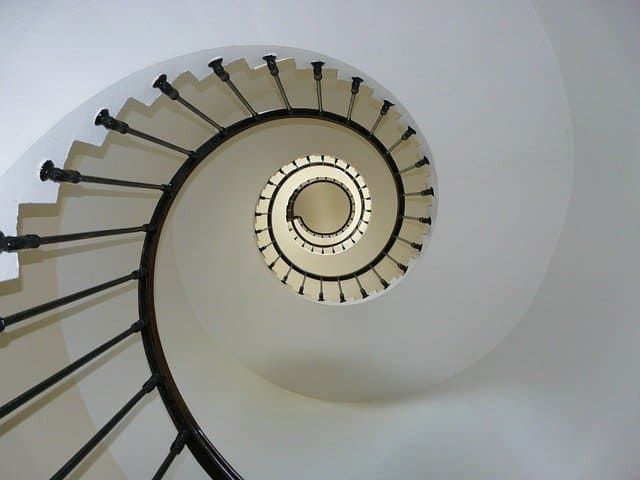"""An image of a spiral staircase from the bottom up.  Image by <a href=""""https://pixabay.com/users/fda54-145996/?utm_source=link-attribution&utm_medium=referral&utm_campaign=image&utm_content=274614"""">fda54</a> from <a href=""""https://pixabay.com/?utm_source=link-attribution&utm_medium=referral&utm_campaign=image&utm_content=274614"""">Pixabay</a>"""