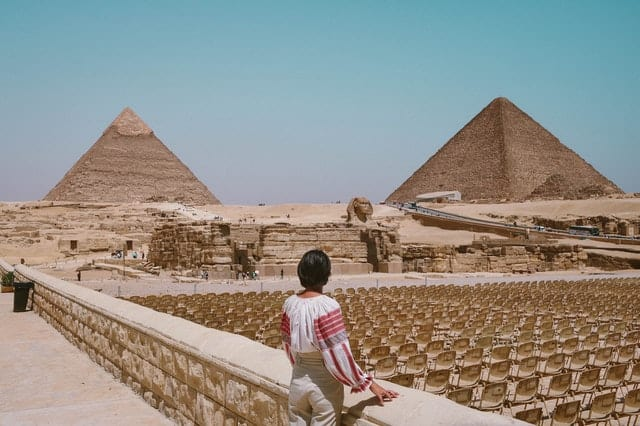 An image of a woman overlooking the pyramids of Egypt  Photo by Andreea Ch from Pexels