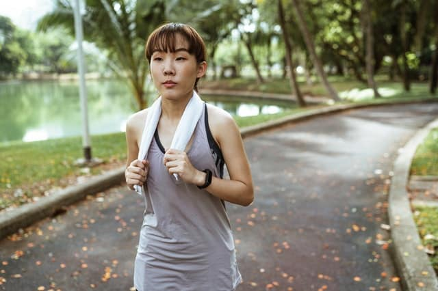 An image of a lady jogging in the park. Photo by Ketut Subiyanto from Pexels